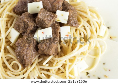 Spaghetti with beef and hot pepper cheese. Selective focus - stock photo