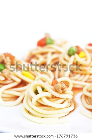 spaghetti with carrot nut and corn on white plate