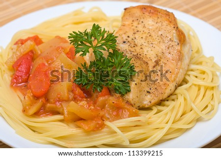 Spaghetti with chicken and vegetable on a plate