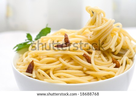 spaghetti with chili pepper and olive oil on white bowl