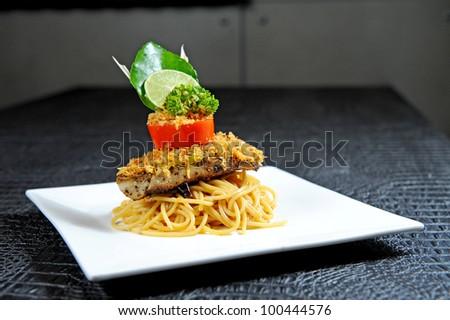 Spaghetti with fish - stock photo
