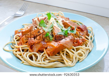 Spaghetti with ham and tomato sauce