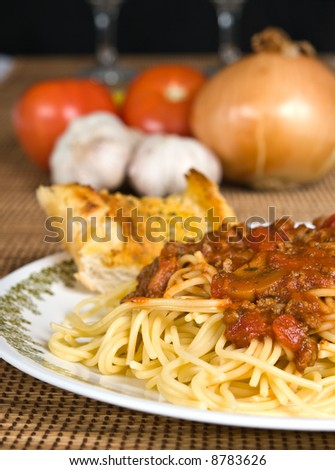 Spaghetti with meat sauce on a plate - stock photo