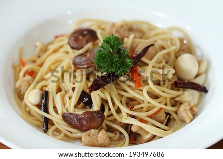 spaghetti with mushroom for vegan on wooded table - stock photo