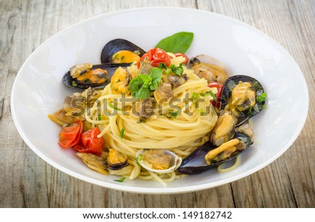Spaghetti with mussels and clams - stock photo