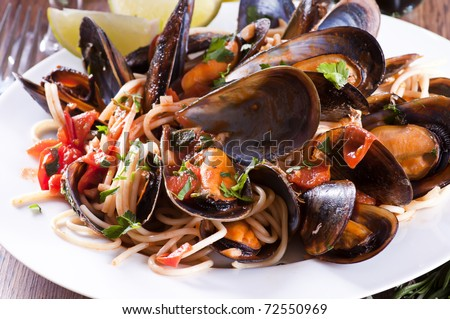 Spaghetti with mussles - stock photo