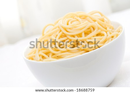 spaghetti with olive oil on white bowl - stock photo