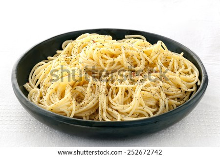 Spaghetti with salt, ground black pepper and butter.  A simple side dish. - stock photo