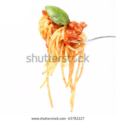Spaghetti with sauce bolognese hanging on a fork decorated with fresh basil - stock photo