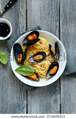 Spaghetti with sea mussels, top view - stock photo