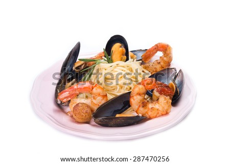 spaghetti with seafood isolated on a white background