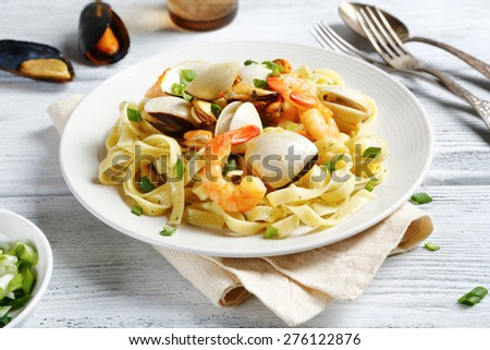 Spaghetti with seafood on a plate, food - stock photo