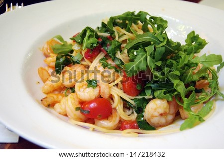 Spaghetti with Shrimps and Tomatoes, a typical Italian pasta dish - stock photo