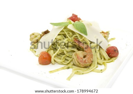 spaghetti with shrimps on a white background in the restaurant - stock photo