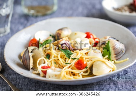Spaghetti with squid, clam and prawn by sea salt