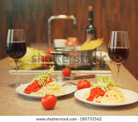Spaghetti with tomato sauce and red wine servesed in a kitchen
