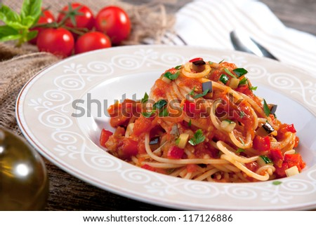 Spaghetti with tomato sauce and vegetable - stock photo