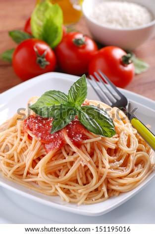 spaghetti with tomato sauce with basil leaf - stock photo