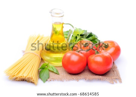 Spaghetti with tomatoes, olive oil and basil on a sacking isolated on white - stock photo