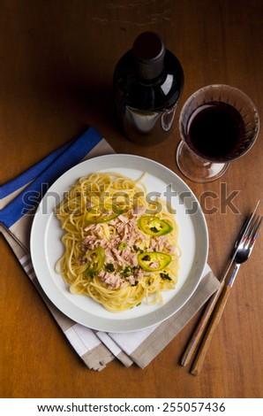 spaghetti with tuna and red wine - stock photo