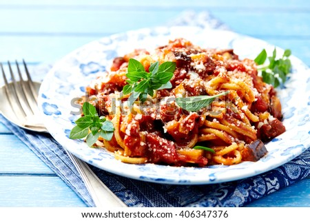 Spaghetti with vegan Bolognese sauce,  Parmesan cheese and Greek Basil - stock photo