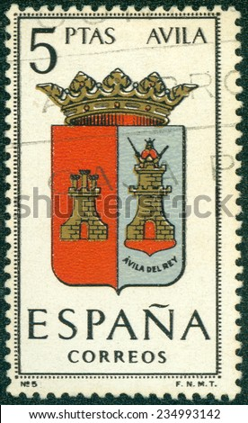 SPAIN - CIRCA 1965: A stamp printed in Spain dedicated to Arms of Provincial Capitals shows Avila, circa 1965. - stock photo