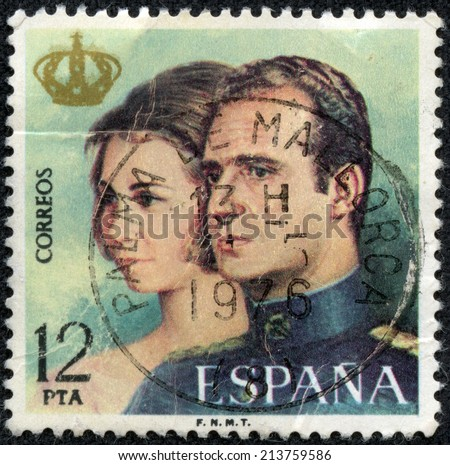 """SPAIN - CIRCA 1975: A stamp printed in Spain from the """"Proclamation of King Juan Carlos I"""" issue shows King Juan Carlos and Queen Sophia, circa 1975. - stock photo"""