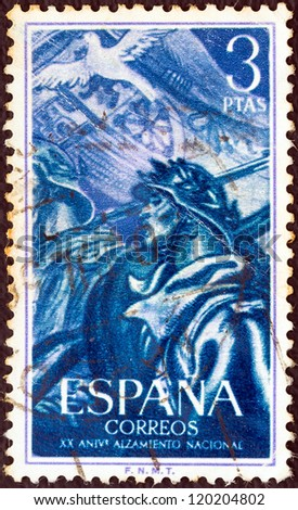 SPAIN - CIRCA 1956: A stamp printed in Spain issued for the 20th anniversary of National uprising shows soldiers and dove, circa 1956.