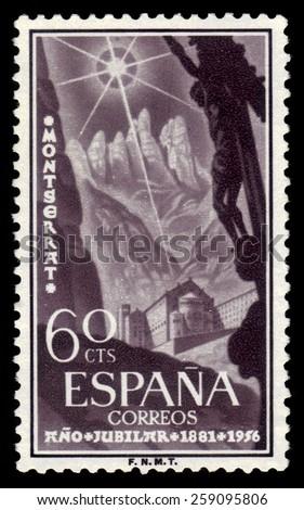 Spain - CIRCA 1956: A stamp printed in Spain shows benedictine abbey at Montserrat, Santa Maria de Montserrat, near Barcelona, Catalonia, Spain, circa 1956 - stock photo