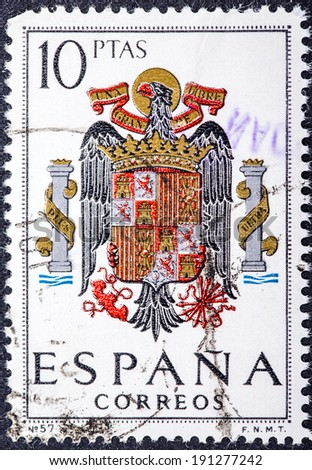 SPAIN - CIRCA 1965: A stamp printed in Spain shows shield of Spain during the Franco dictatorship, circa 1965. - stock photo