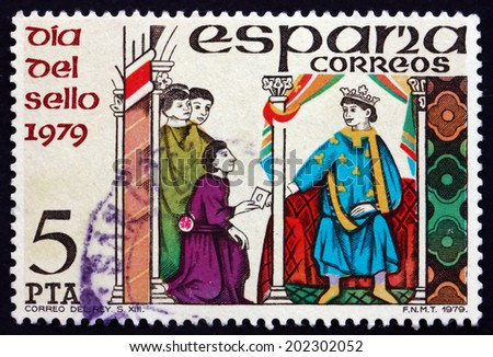SPAIN - CIRCA 1979: a stamp printed in the Spain shows Messenger Handing Letter to King, Stamp Day, circa 1979 - stock photo