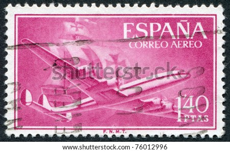 SPAIN-CIRCA 1955: A stamp printed in the Spain, the postal service shows the aircraft Lockheed L-1049, circa 1955 - stock photo