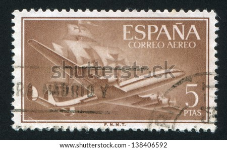 SPAIN - CIRCA 1955: stamp printed by Spain, shows plane and ship, circa 1955 - stock photo