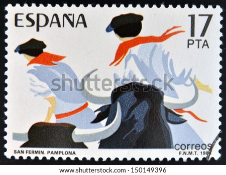 SPAIN - CIRCA 1984: stamp printed in Spain shows Sanfermines in Pamplona, circa 1984  - stock photo