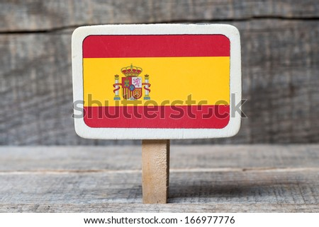 Spain flag on Small wooden framed blackboard on wooden background - stock photo