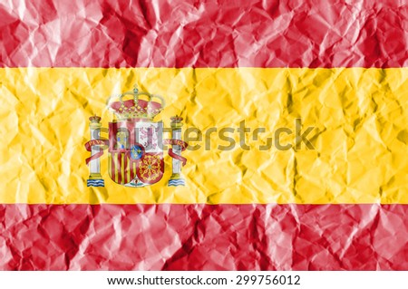 Spain flag painted on crumpled paper background. - stock photo