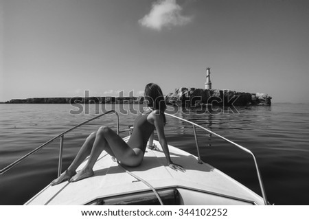 SPAIN, Ibiza, Espardell island, girl on a boat - FILM SCAN - stock photo