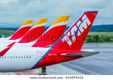 Spain, Madrid, international airport Barahas - May 6, 2016. Bright coloring of aircraft tails during passangers embarkation
