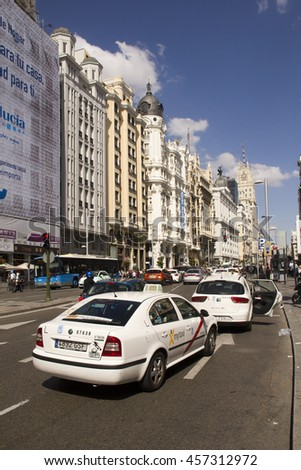 Spain,Madrid - May 27, 2016: Traffic of taxi cabs and other cars in the Gran Via main street in Madrid, Spain on May 27, 2016 - stock photo