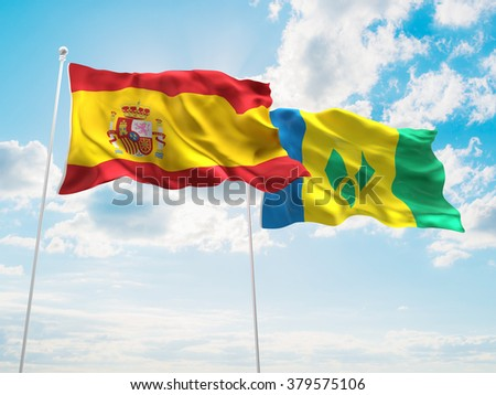 Spain & Saint Vincent and the Grenadines Flags are waving in the sky