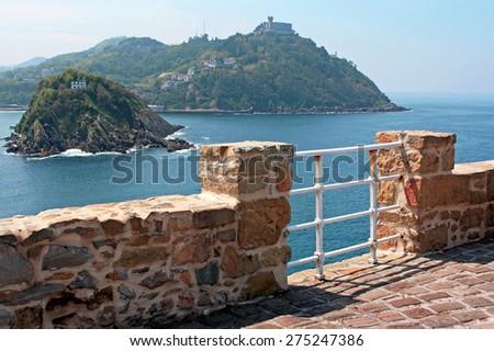 Spain. San Sebastian. View of the island Santa Klara, located in the center of the Gulf of La Concha. - stock photo