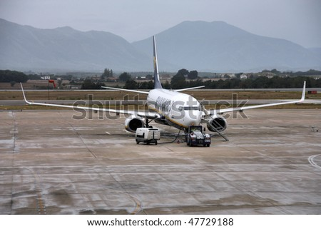 SPAIN - SEPTEMBER 15: Boeing 737 of Ryanair refueled on September 15, 2009 at Girona Costa Brava Airport. Ryanair is currently biggest airline in the world (int'l passengers carried yearly). - stock photo