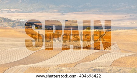 Spain, written on a background of Fields and hills of Castilla-La Mancha at winter - stock photo