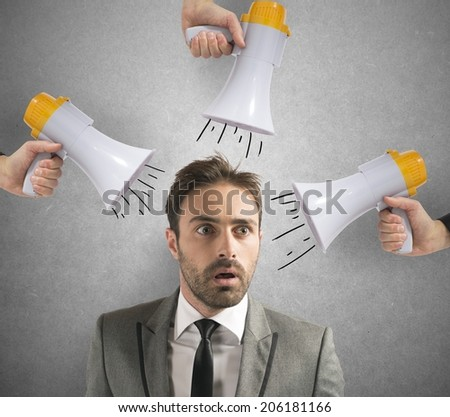 Spam concept with businessman receives a noisy ad - stock photo