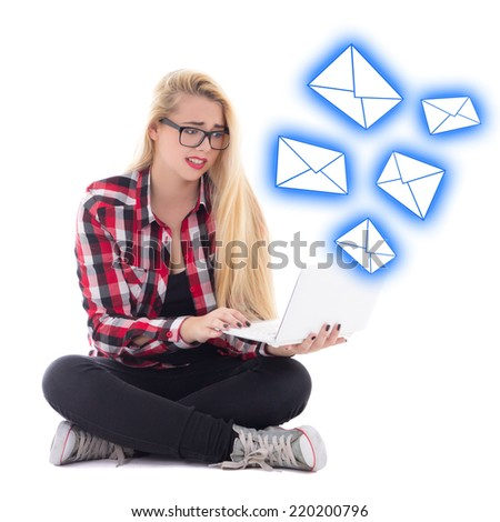 spam concept - young beautiful astonished blondie woman sitting with laptop isolated on white background - stock photo