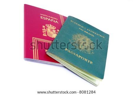 Spanish and Brazilian Passport on white background. - stock photo