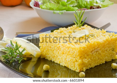 spanish and mediterranean yellow rice style on black platter