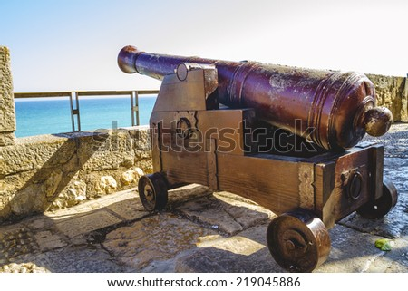 Spanish cannon pointing out to sea fortress - stock photo