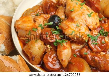Spanish chicken stew with chorizo sausage,olives and new potatoes. - stock photo