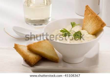 Spanish Cuisine. Brandada de bacalao. Salt cod with mashed potatoes. Selective focus. White background.